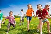 Group of running kids — Stock Photo