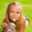 One blond girls with butterfly in jar — Stock Photo
