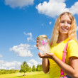 Teen girl with butterfly jar — Stock Photo