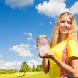 Teen girl with butterfly jar — Stock Photo #32010415