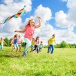 Run with kite for fun — Stock Photo #32010427