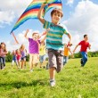 Many kids run with kite — Stock Photo #32010459