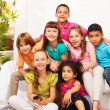 Group of kids with TV remote controll — Stock Photo