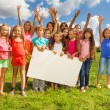 Group of kids with placecard — Stock Photo #32010629