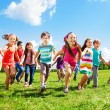 Kids running enjoying summer — Stock Photo