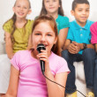 Close portrait of girl singing — Stock Photo