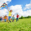 Boy with kite and friends — Stock Photo