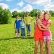 Girls standing in the park hugging — Stock Photo