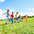 Many boys and girls running — Stock Photo #32010975