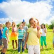 Stock Photo: Many kids on little girl's birthday