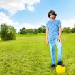 Boy standing with soccer ball — Stock Photo