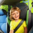 3 years old boy in the back child seat — Stock Photo #32011617