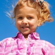 Close portrait of little girl in pink — Stock Photo