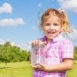 6 years old girl with butterfly jar — Stock Photo