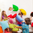 Kids playing pillow fight — Stock Photo