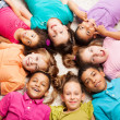 Group of eight happy kids in star shape — Stock Photo #32012049