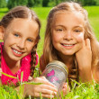 Two friends with jar and butterfly — Stock Photo