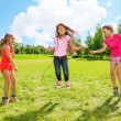 Stock Photo: Girls play jumping over the rope