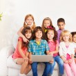 Happy group of kids with laptop — Stock Photo