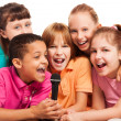 Portrait of kids singing together — Stock Photo