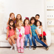Group of happy hugging kids at home — Stock Photo #32012553