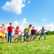 Many kids running in the field — Stock Photo #32012587