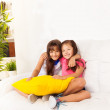 Two little girls with pillows — Stock Photo