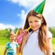 Stock Photo: Happy smiling girl on birthday party