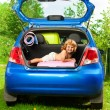 Boy in the trunk with baggage — Stock Photo