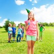 Girl outside with friends celebrate birthday — Stock Photo
