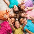 Kids in star shape laying on the floor — Stock Photo