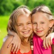 Two happy girls hugging — Stock Photo #32012715