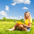 Teen girl with book in the park — Stock Photo