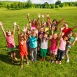 Huge group of kids in the park — Stock Photo #32012861