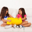 Two little girls fighting over pillow — Stock Photo