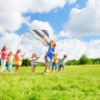 Fun with kite for many kids — Stock Photo