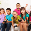 Kids playing computer games as team — Stock Photo