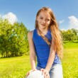 Cute girl sit in grass with ball — Stock Photo