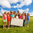 Kids with board for copy space — Stock Photo