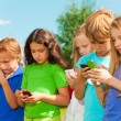 Group of kids sms — Stock Photo
