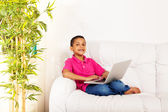 Cute boy with laptop — Stock Photo