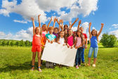 Many kids with white board — Stock Photo