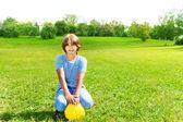 Boy with football ball — Stock Photo