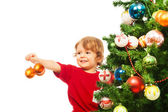 Decorating Christmas tree with balls — Stock Photo