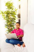 Boy with laptop on the sofa — Stockfoto