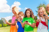 Kids occupied with phone — Stock Photo