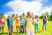 Many kids on little girl's birthday — Stock Photo