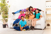 School boys and girls at home together — Stock Photo