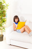 Brunet girl with book — Stock Photo