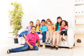 Cute kids on a couch — Stock Photo